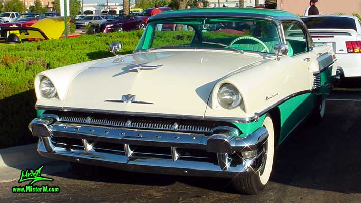 Photo of a white & turkquoise 1956 Mercury Monterey 4 Door Hardtop Sedan at the Scottsdale Pavilions Classic Car Show in Arizona. 1956 Mercury Chrome Grill & Head Lights