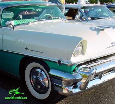 Photo of a white & turkquoise 1956 Mercury Monterey 4 Door Hardtop Sedan at the Scottsdale Pavilions Classic Car Show in Arizona. 1956 Mercury Head Light