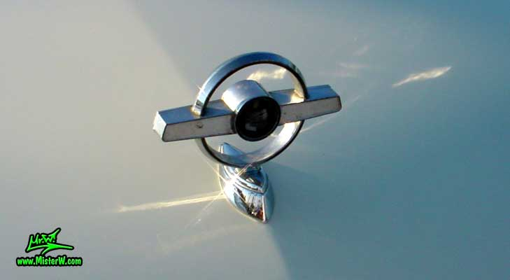 Photo of a white & turkquoise 1957 Mercury Monterey 2 Door Convertible at the Scottsdale Pavilions Classic Car Show in Arizona. 1957 Mercury Hood Ornament