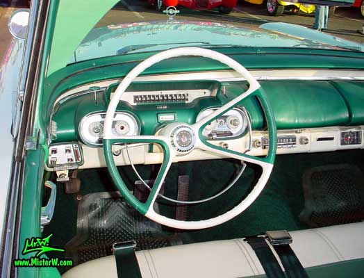 Photo of a white & turkquoise 1957 Mercury Monterey 2 Door Convertible at the Scottsdale Pavilions Classic Car Show in Arizona. 1957 Mercury Odometer