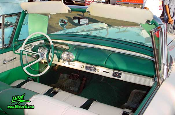 Photo of a white & turkquoise 1957 Mercury Monterey 2 Door Convertible at the Scottsdale Pavilions Classic Car Show in Arizona. 1957 Mercury Dash Board & Steering Column
