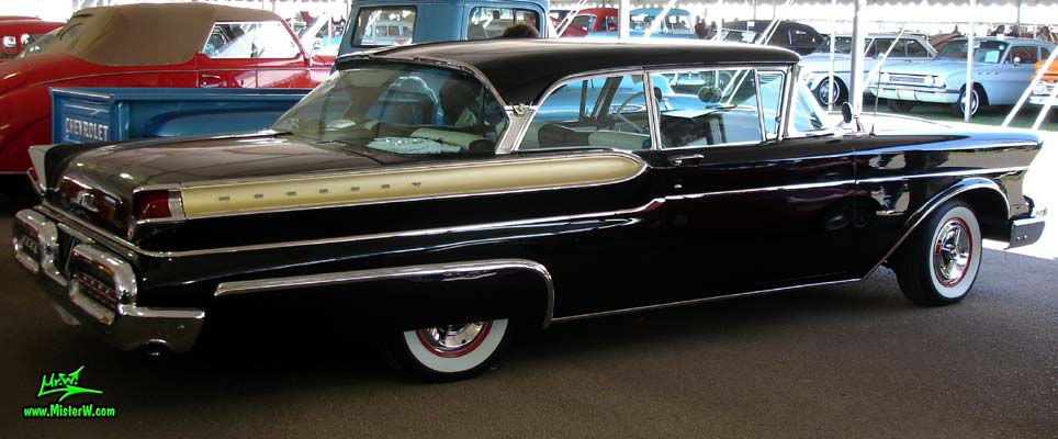 Photo of a black 1957 Mercury 2 Door Hardtop Coupe at a classic car auction in Scottsdale, Arizona. Sideview of a 57 Mercury 2 Door Hardtop Coupe