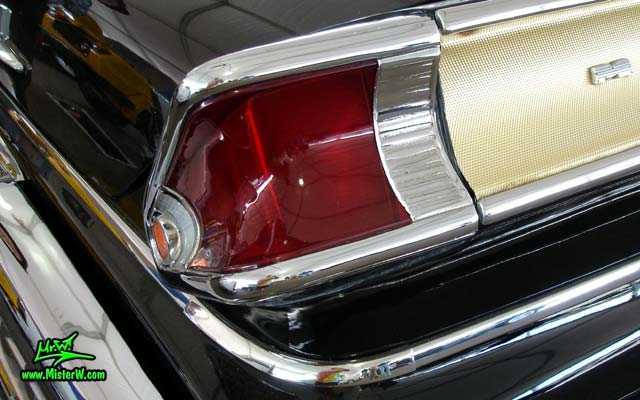 Photo of a black 1957 Mercury 2 Door Hardtop Coupe at a classic car auction in Scottsdale, Arizona. Tail Light of a 57 Mercury Hardtop Coupe