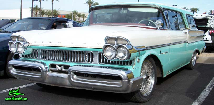 Photo of a white & turkquoise 1957 Mercury Voyager 2 Door Station Wagon at the Scottsdale Pavilions Classic Car Show in Arizona. Sideview of a 57 Mercury Voyager 2 Door Stationwagon