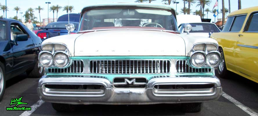 Photo of a white & turkquoise 1957 Mercury Voyager 2 Door Station Wagon at the Scottsdale Pavilions Classic Car Show in Arizona. Frontview of a 57 Mercury Voyager 2 Door Stationwagon