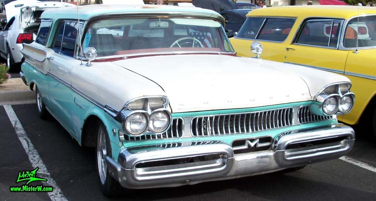 Photo of a white & turkquoise 1957 Mercury Voyager 2 Door Station Wagon at the Scottsdale Pavilions Classic Car Show in Arizona. 57 Mercury Station Wagon Chrome Grill & Bumper
