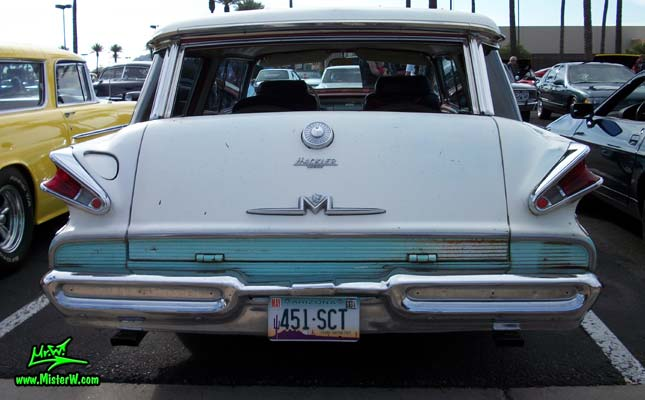 Photo of a white & turkquoise 1957 Mercury Voyager 2 Door Station Wagon at the Scottsdale Pavilions Classic Car Show in Arizona. Rearview of a 57 Mercury Voyager 2 Door Stationwagon