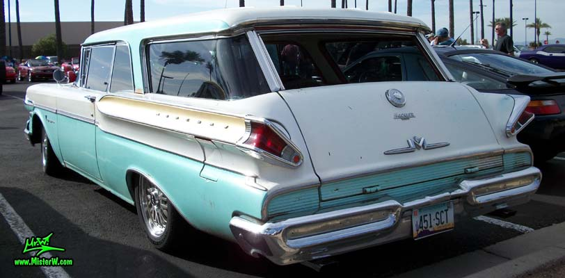Photo of a white & turkquoise 1957 Mercury Voyager 2 Door Station Wagon at the Scottsdale Pavilions Classic Car Show in Arizona. Tailfins of a 57 Mercury Voyager 2 Door Stationwagon