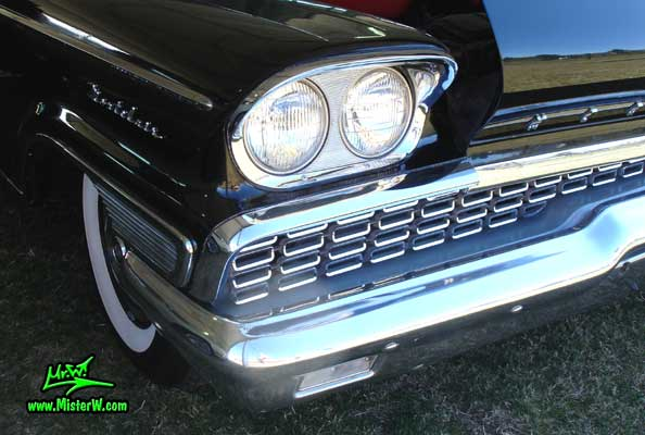 Photo of a black 1959 Mercury Montclair 2 Door Hardtop Coupe at a Classic Car Auction in Scottsdale, Arizona. 1959 Mercury Head Light