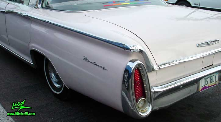 Photo of a white 1960 Mercury Monterey 4 Door Hardtop Sedan at the Scottsdale Pavilions Classic Car Show in Arizona. 60 Mercury Tail Fin & Rear Light