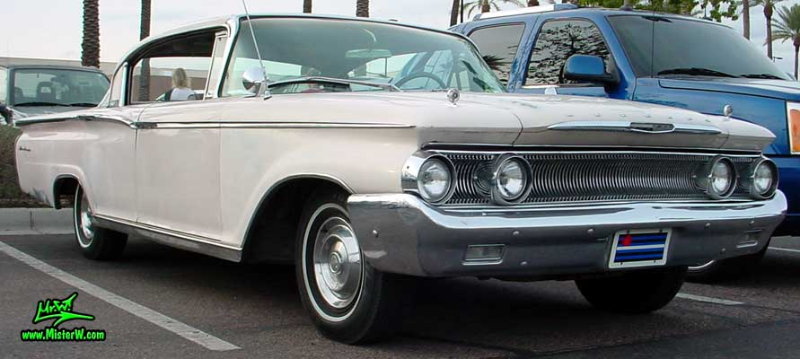 Photo of a white 1960 Mercury Monterey 4 Door Hardtop Sedan at the Scottsdale Pavilions Classic Car Show in Arizona. 1960 Mercury Monterey Sedan Frontview