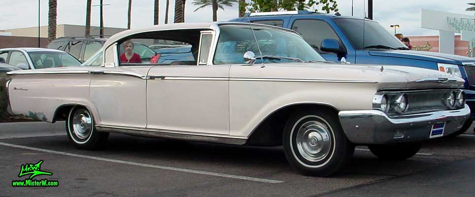 Photo of a white 1960 Mercury Monterey 4 Door Hardtop Sedan at the Scottsdale Pavilions Classic Car Show in Arizona. 1960 Mercury Monterey Sedan Sideview