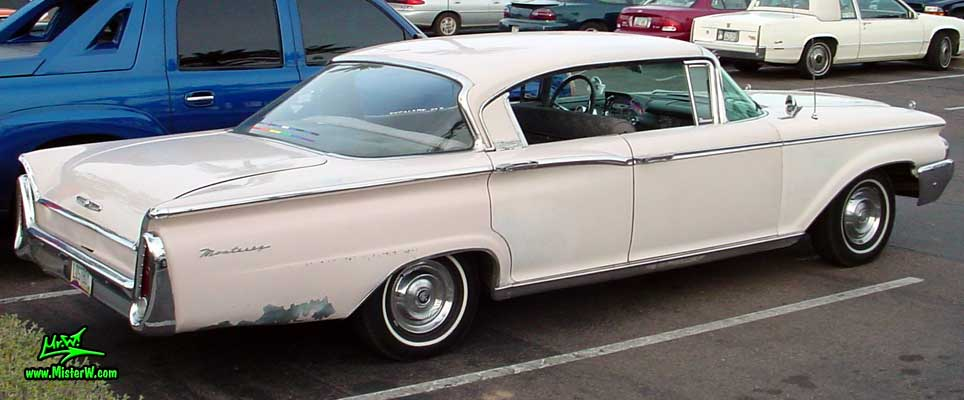 Photo of a white 1960 Mercury Monterey 4 Door Hardtop Sedan at the Scottsdale Pavilions Classic Car Show in Arizona. 1960 Mercury Monterey Sedan Rearview