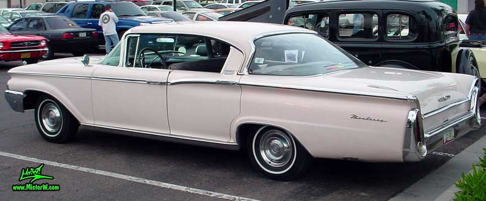 Photo of a white 1960 Mercury Monterey 4 Door Hardtop Sedan at the Scottsdale Pavilions Classic Car Show in Arizona. 1960 Mercury Monterey Sedan Tail Fins