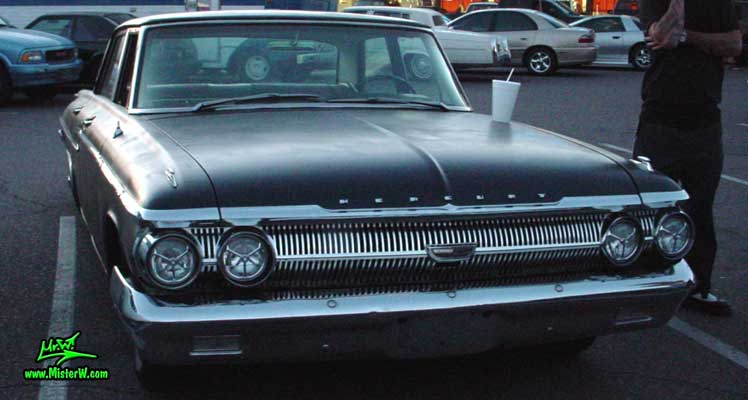 Photo of a flat black 1962 Mercury 4 Door Hardtop Sedan at a Classic Car Meeting in Arizona. 1962 Mercury Frontview