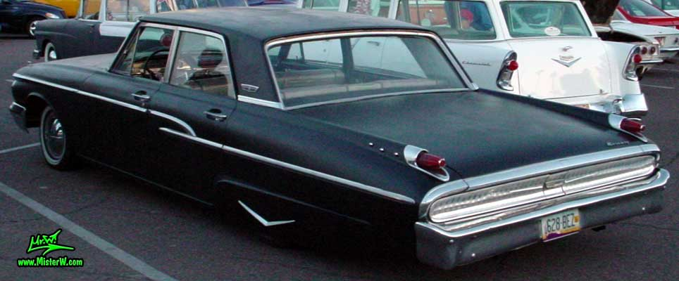 Photo of a flat black 1962 Mercury 4 Door Hardtop Sedan at a Classic Car Meeting in Arizona. 1962 Mercury Sideview