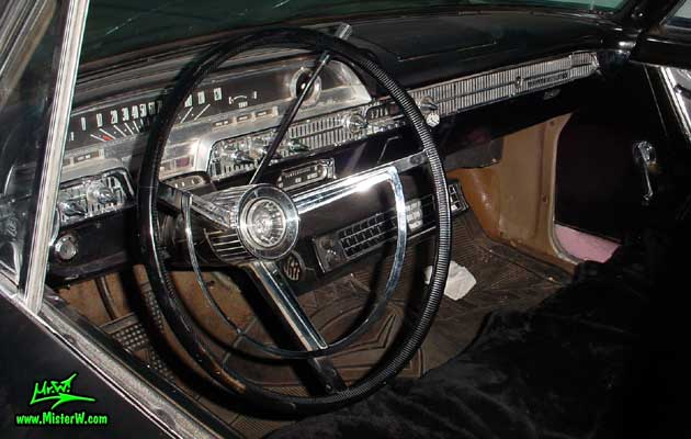 Photo of a flat black 1962 Mercury 4 Door Hardtop Sedan at a Classic Car Meeting in Arizona. 1962 Mercury Dashboard & Odometer