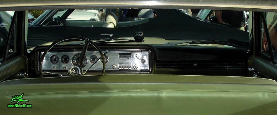 Photo of a tan & white 1965 Mercury 4 door sedan at the Scottsdale Pavilions Classic Car Show in Arizona. Dashboard, speedometer & interior of a 1965 Mercury