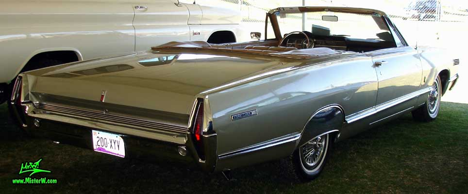 Photo of a silver 1967 Mercury 2 Door Convertible at a Classic Car Auction in Scottsdale, Arizona. 1967 Mercury Convertible Sideview