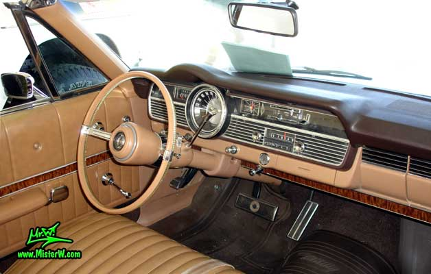 Photo of a silver 1967 Mercury 2 Door Convertible at a Classic Car Auction in Scottsdale, Arizona. 1967 Mercury Dash Board & Steering Column