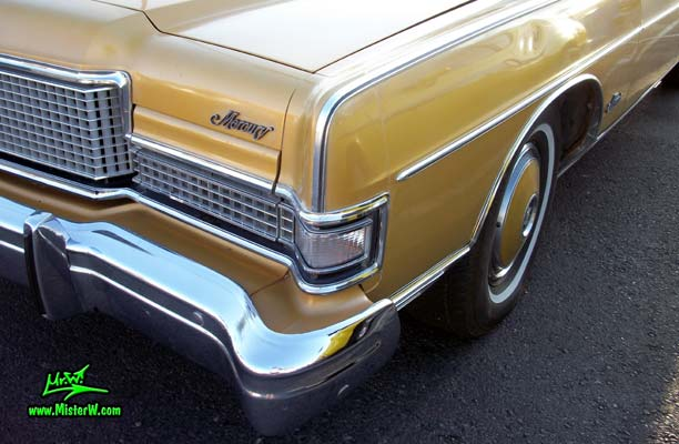 Photo of a gold brown 1973 Mercury 2 door hartop coupe at the Scottsdale Pavilions Classic Car Show in Arizona. Front blinker & chrome of a 1973 Mercury Hartop Coupe