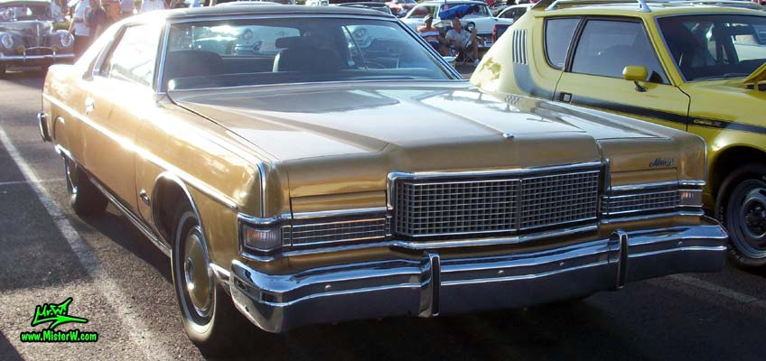 Photo of a gold brown 1973 Mercury 2 door hartop coupe at the Scottsdale Pavilions Classic Car Show in Arizona. Frontview of a 1973 Mercury Hartop Coupe
