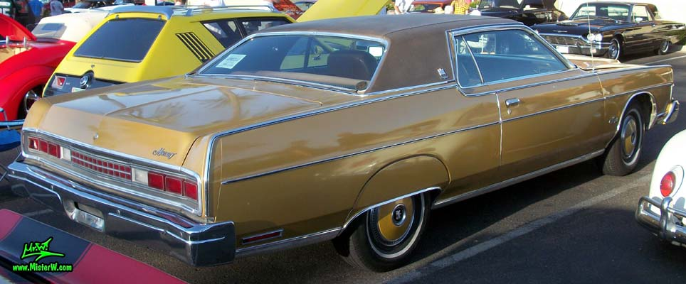 Photo of a gold brown 1973 Mercury 2 door hartop coupe at the Scottsdale Pavilions Classic Car Show in Arizona. Sideview of a 1973 Mercury Hartop Coupe