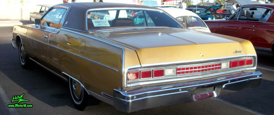 Photo of a gold brown 1973 Mercury 2 door hartop coupe at the Scottsdale Pavilions Classic Car Show in Arizona. Rearview of a 1973 Mercury Hartop Coupe