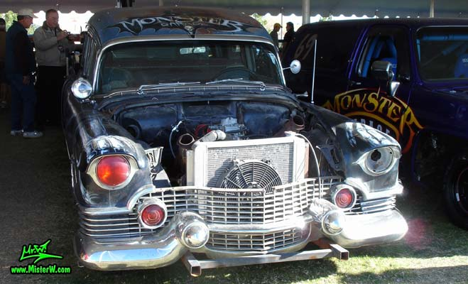 Photo of the Hearse Grave Digger a Monster Garage modified 54 Caddy with backhoe at a classic car auction in Scottsdale, Arizona. Frontview of Grave Digger the Monster Garage Hearse