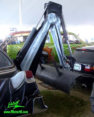Photo of the Hearse Grave Digger a Monster Garage modified 54 Caddy with backhoe at a classic car auction in Scottsdale, Arizona. Grave Digger the Monster Garage Hearse with a backhoe for digging graves
