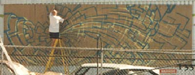 Werner Skolimowski paining a Big Mural in Sunnyslope, Arizona, April 1997