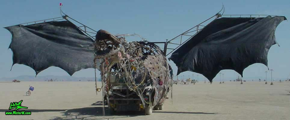 Photo of Draka the Dragon Mutant Vehicle / Art Car by Lisa Nigro in Black Rock City, Nevada, 2002. Draka Mutant Vehicle