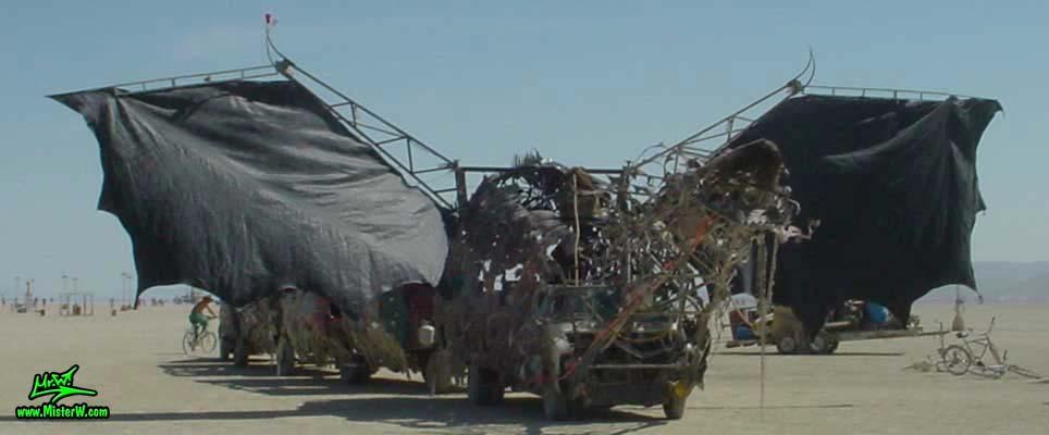 Photo of Draka the Dragon Mutant Vehicle / Art Car by Lisa Nigro in Black Rock City, Nevada, 2002. Draka Art Ride