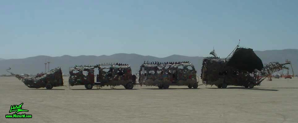 Photo of Draka the Dragon Mutant Vehicle / Art Car by Lisa Nigro in Black Rock City, Nevada, 2002. Draka Sideview