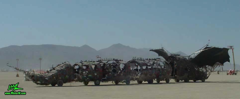 Photo of Draka the Dragon Mutant Vehicle / Art Car by Lisa Nigro in Black Rock City, Nevada, 2002. Draka's Trailers