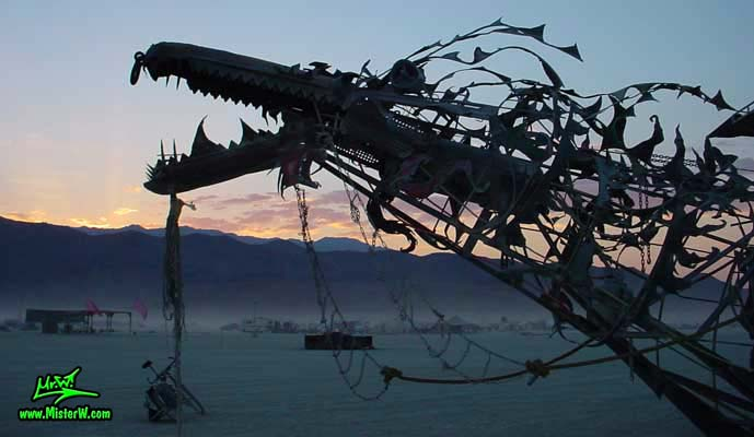 Photo of Draka the Dragon Mutant Vehicle / Art Car by Lisa Nigro in Black Rock City, Nevada, 2002. Draka's Head At Sunset