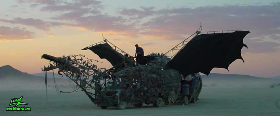 Photo of Draka the Dragon Mutant Vehicle / Art Car by Lisa Nigro in Black Rock City, Nevada, 2002. Shot Of Draka At Sunset
