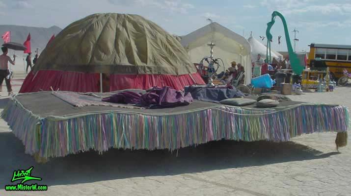 Photo of the Magic Carpet Ride Mutant Vehicle / Art Car in Black Rock City, Nevada, 2004. Magic Carpet Ride Mutant Vehicle