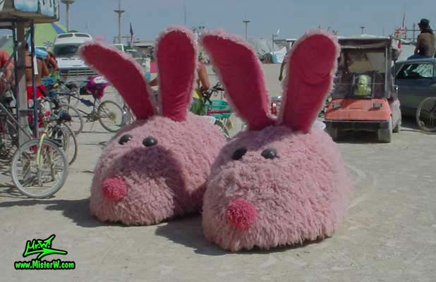 Photo of the giant electric powered Pink Bunny Slippers Mutant Vehicles / Art Cars in Black Rock City, Nevada, 2002. Giant Pink Bunny Slipper Art Cars