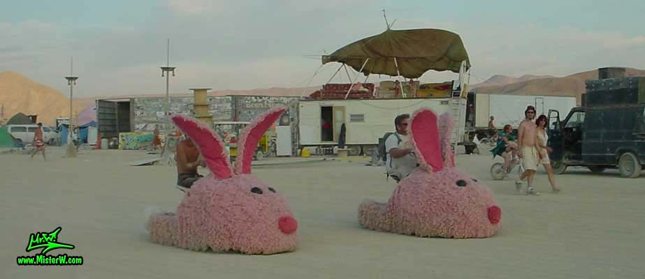 Photo of the giant electric powered Pink Bunny Slippers Mutant Vehicles / Art Cars in Black Rock City, Nevada, 2002. Motorized Pink Bunny Slipper Mutant Vehicles