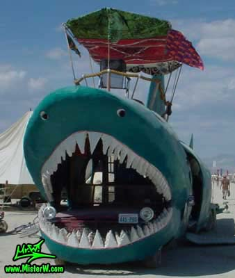 Photo of the Shark Bar Mutant Vehicle / Art Car in Black Rock City, Nevada, 2002. Shark Mutant Vehicle