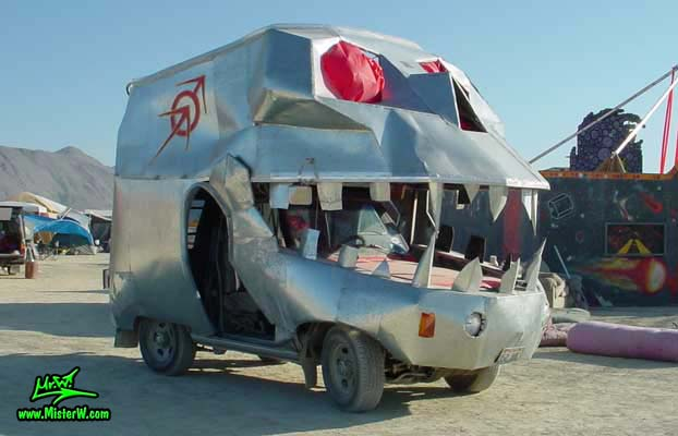 Photo of a Silver Skull Mutant Vehicle / Art Car in Black Rock City, Nevada, 2002. Silver Skull Mutant Vehicle