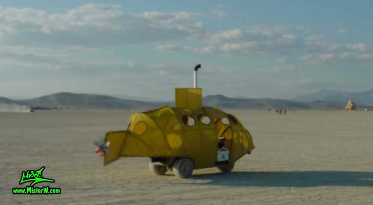 Photo of a yellow Submarine Mutant Vehicle / Art Car in Black Rock City, Nevada, 2002. Yellow Submarine Mutant Vehicle