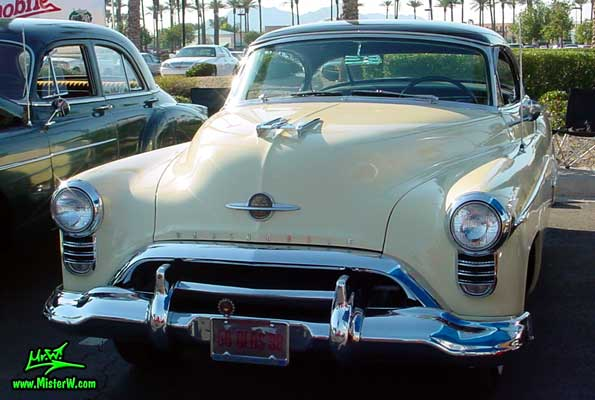 Photo of a white 1950 Oldsmobile 98 2 Door Hardtop Coupe at the Scottsdale Pavilions Classic Car Show in Arizona. 1950 Oldsmobile 98