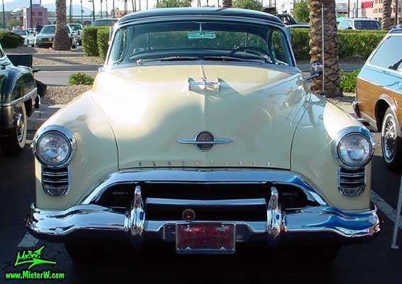 Photo of a white 1950 Oldsmobile 98 2 Door Hardtop Coupe at the Scottsdale Pavilions Classic Car Show in Arizona. 1950 Oldsmobile 98 Frontview