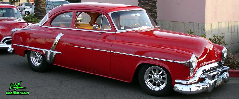 Photo of a red 1951 Oldsmobile 2 Door Hardtop Coupe at the Scottsdale Pavilions Classic Car Show in Arizona. 1951 Oldsmobile