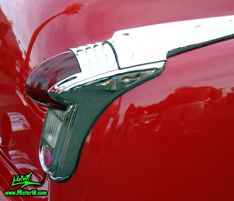 Photo of a red 1951 Oldsmobile 2 Door Hardtop Coupe at the Scottsdale Pavilions Classic Car Show in Arizona. 1951 Oldsmobile Taillight