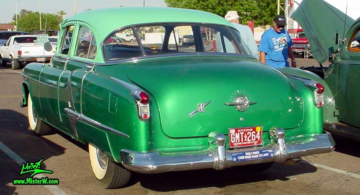 Photo of a green 1952 Oldsmobile 88 4 Door Hardtop Sedan at a Classic Car Meeting in Phoenix, Arizona. 1952 Oldsmobile Sideview