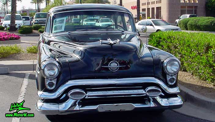 Photo of a black 1953 Oldsmobile 88 2 Door Hardtop Coupe at the Scottsdale Pavilions Classic Car Show in Arizona. 1953 Oldsmobile 88