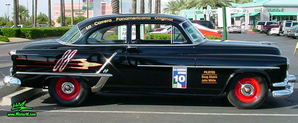 Photo of a black 1953 Oldsmobile 88 2 Door Hardtop Coupe at the Scottsdale Pavilions Classic Car Show in Arizona. 1953 Oldsmobile Sideview